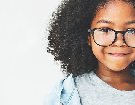 Smiling girl in glasses.